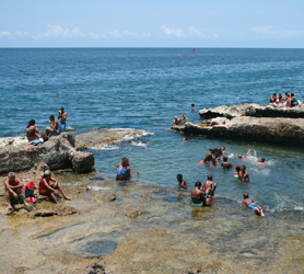 Kids swim in Cuba Travel